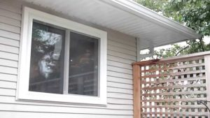 new vinyl window installation in vinyl siding